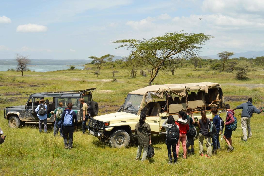 Volunteers get into their vehicles after working in Soysambu conservancy.